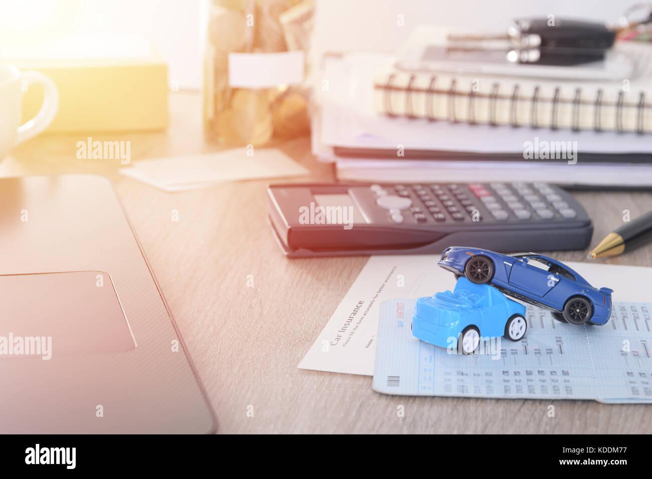 Car insurance concept:Car claim form with car toy crash on desk - Stock Image