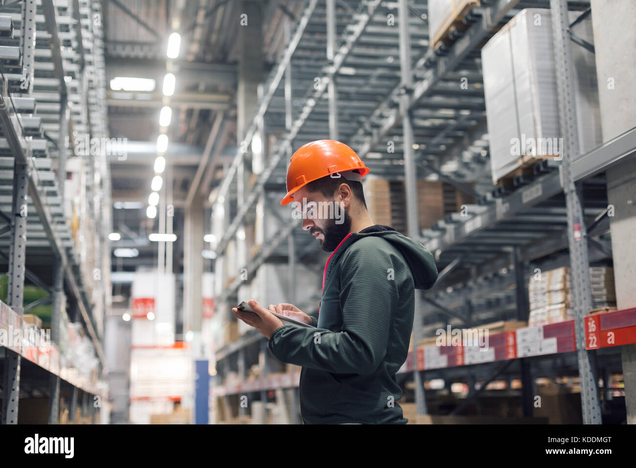 wholesale, logistic, people and export concept - manager or supervisor with tablet at warehouse - Stock Image