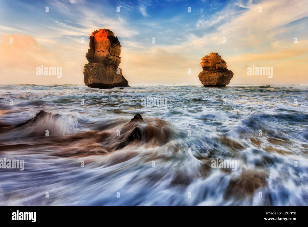 2 limestone apostles off Gibson steps beach at Twelve apostles marine park during sunrise sunlight. - Stock Image
