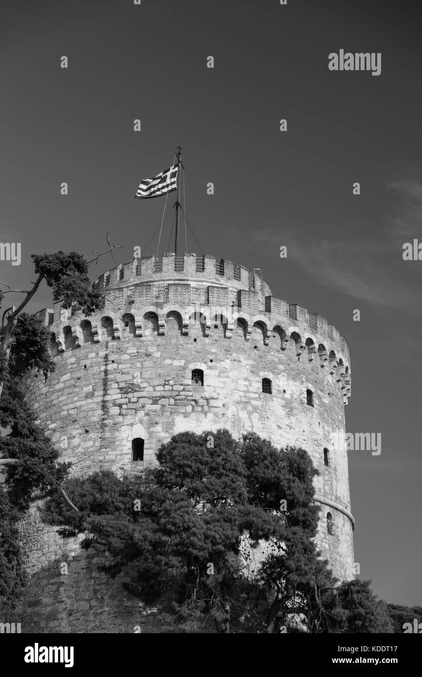 Ancient stone tower with Greek flag on the top - Stock Image