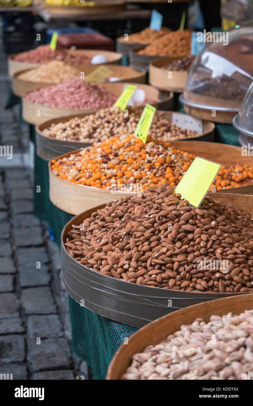 Various baked seeds and nuts in authentic Greek market with empty price tags - Stock Image