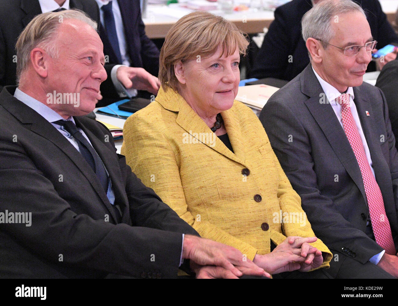 Hanover, Germany. 12th Oct, 2017. German Chancellor Angela Merkel (CDU) sits next to the chairman of the IG BCE, Stock Photo