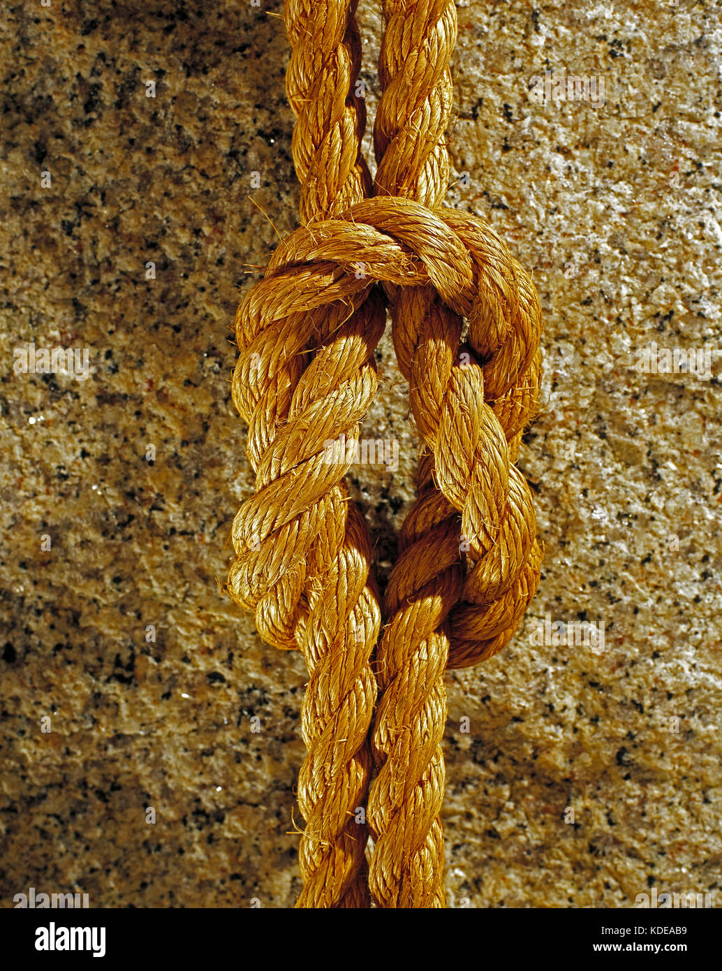 Still life. Close up of rope tied as reef knot. - Stock Image