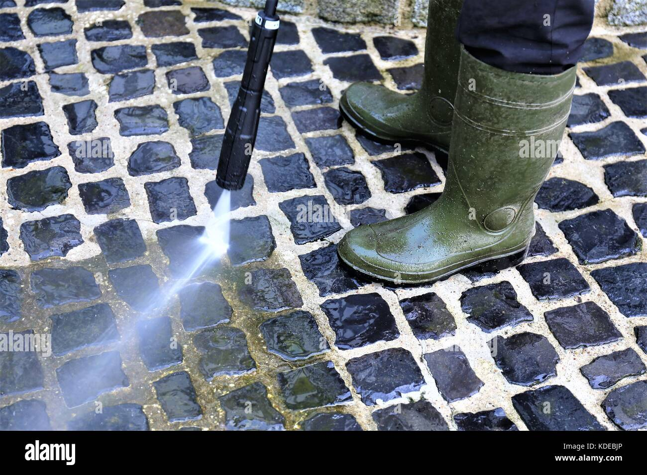 An Image of walkway cleaning - high pressure cleaner - Stock Image