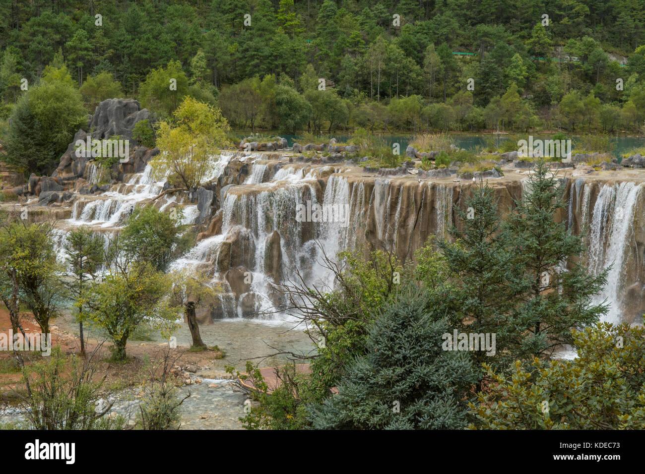 Waterfall at Jade Dragon Snow Mountain, Lijiang, Yunnan, China - Stock Image