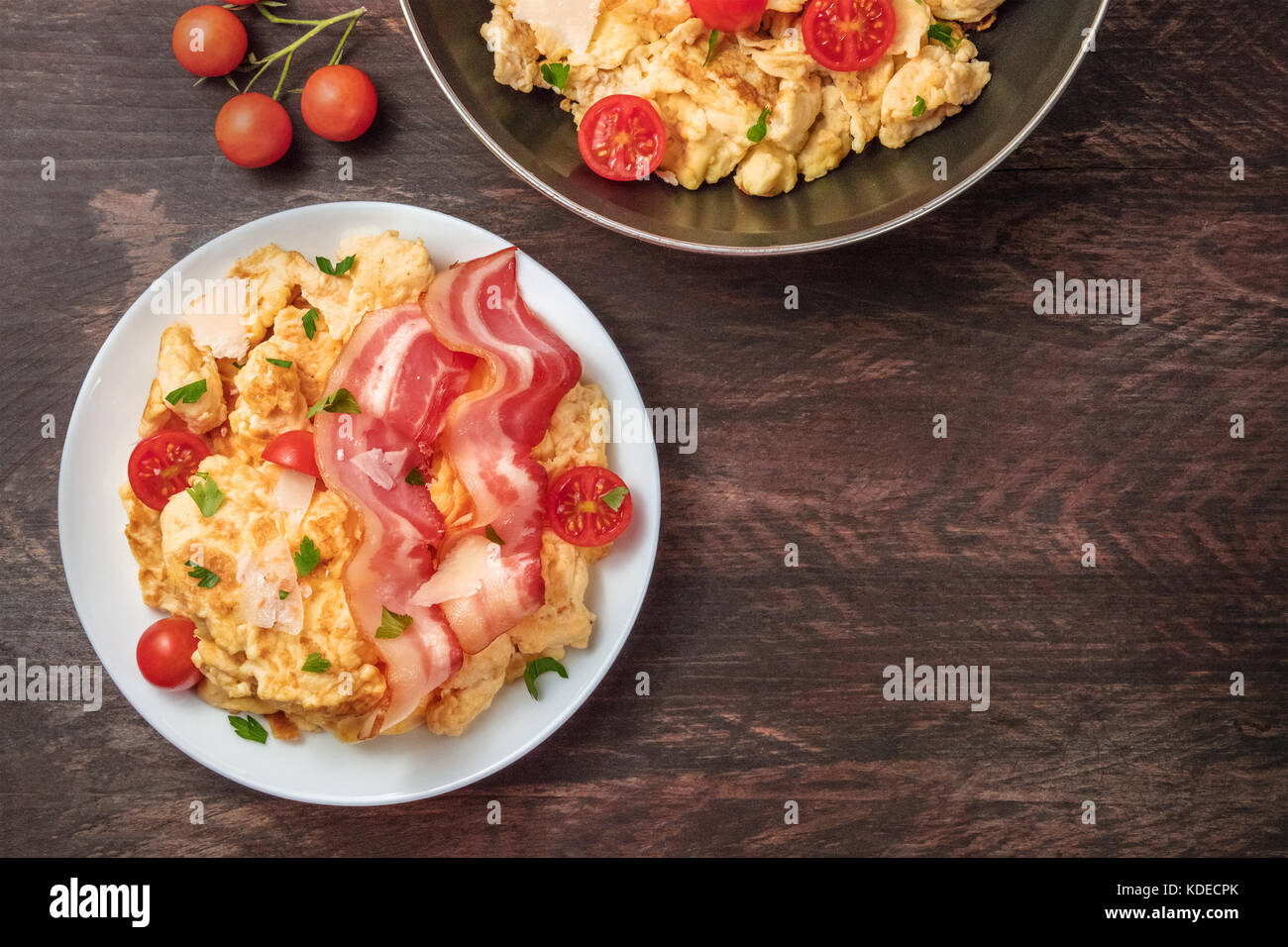 Scrambled eggs with cheese, bacon, and copy space - Stock Image