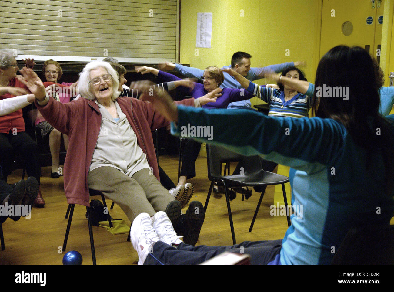 Over 50's, elderly club trying out gentle Zumba exercises at the Stephen's Hall in west London. - Stock Image