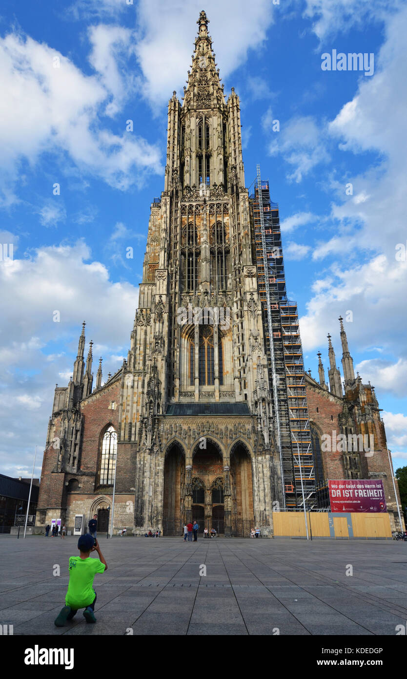Ulm, Germany - 28th July 2017: Boy taking picture of Ulm Minster (Ulmer Münster) Stock Photo