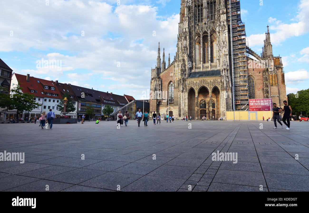 Ulm, Germany - 28th July 2017: Ulm Minster and Marketplace with tourists Stock Photo