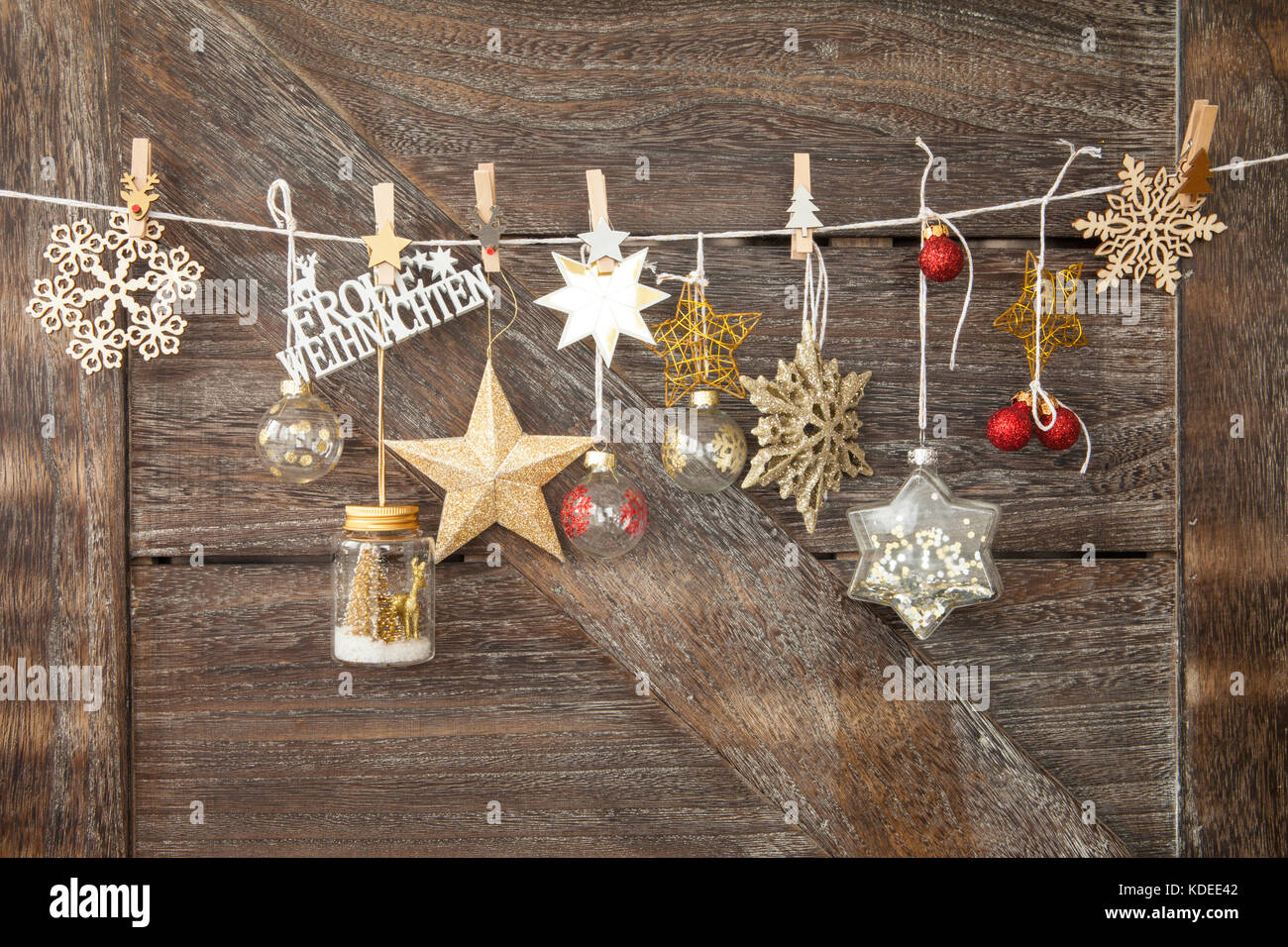 Rustic Wooden Christmas Background With Festive Ornaments Frohe Weihnachten Translates To Merry