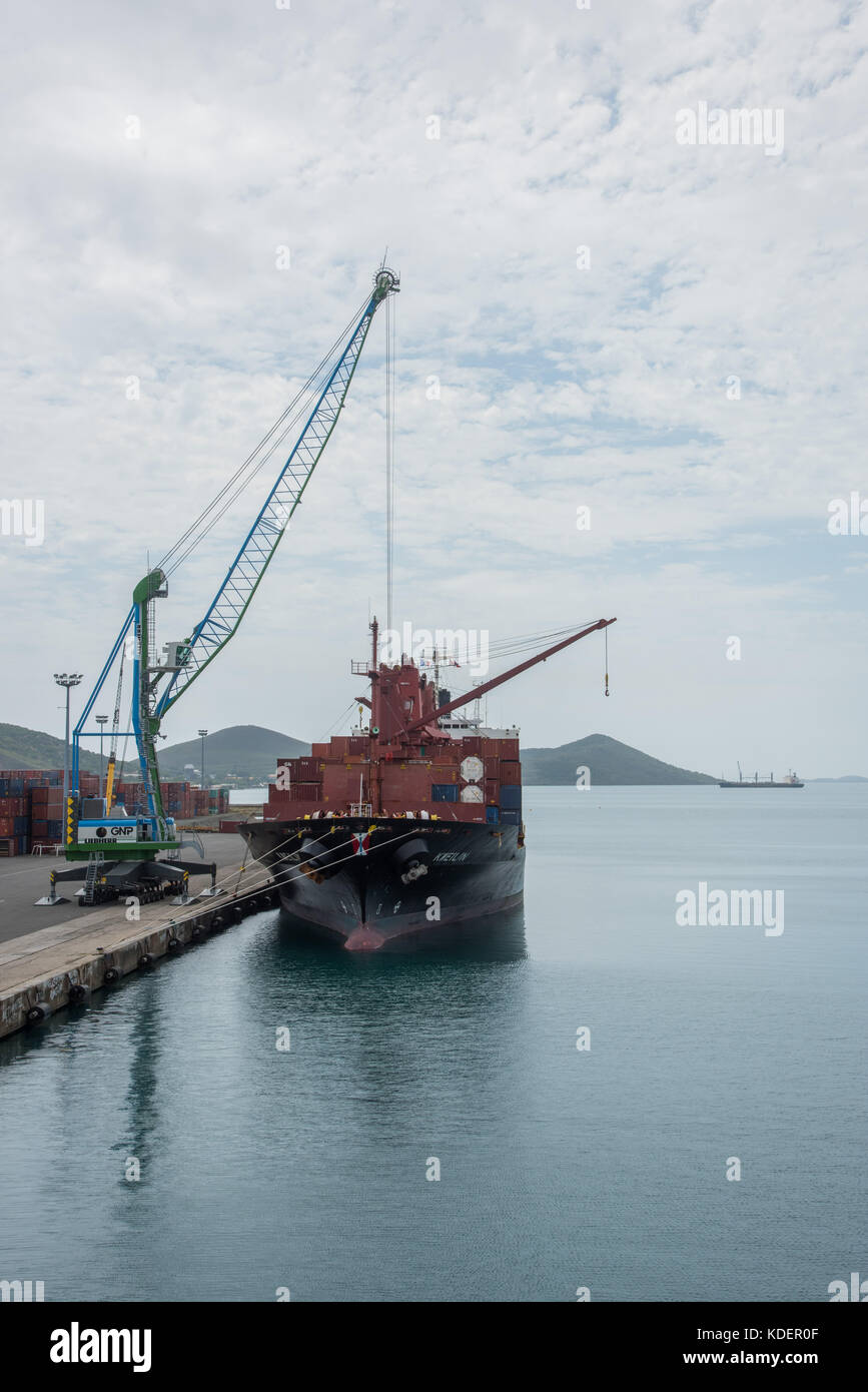 NOUMEA, NEW CALEDONIA-NOVEMBER 25,2016: Commercial dock with ship and crane in Noumea, New Caledonia - Stock Image