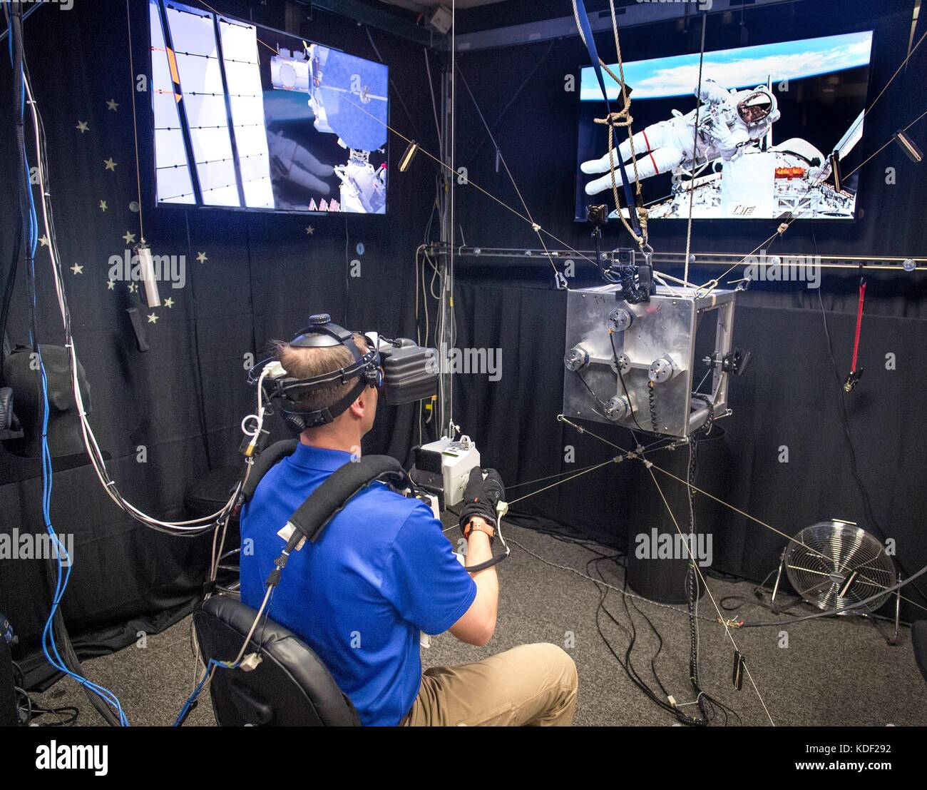 NASA astronaut Nick Hague uses a virtual reality simulator during a
