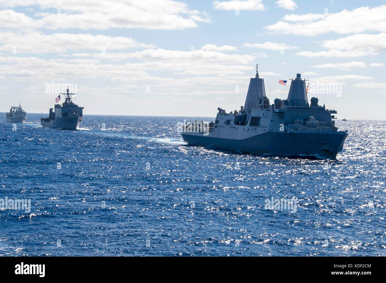 The U.S. Navy San Antonio-class amphibious transport dock ship USS Green Bay steams in formation with U.S. and Royal - Stock Image