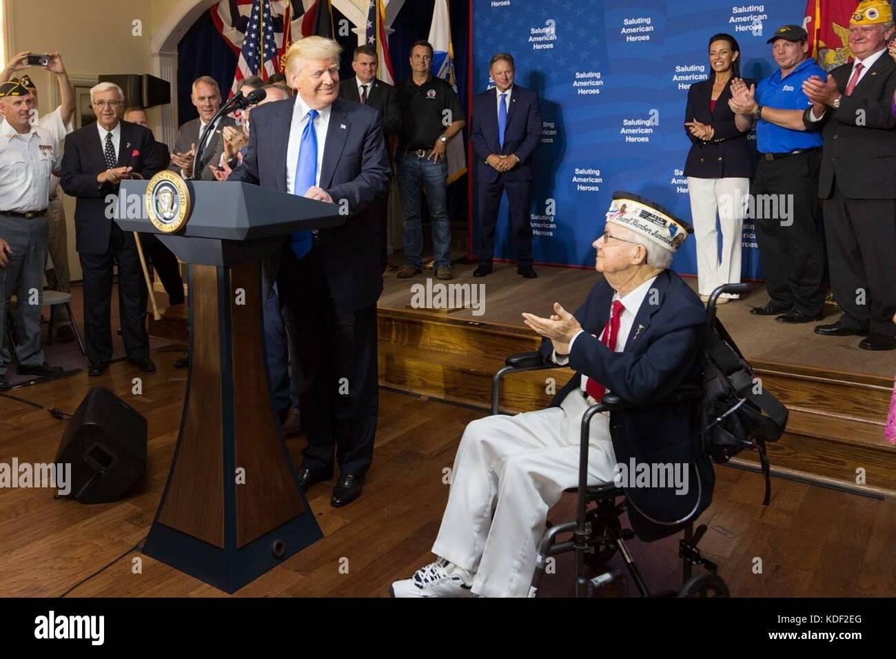 U.S. President Donald Trump honors World War II veteran Bob Bishop during the AMVETS Post 44 Salute to American - Stock Image