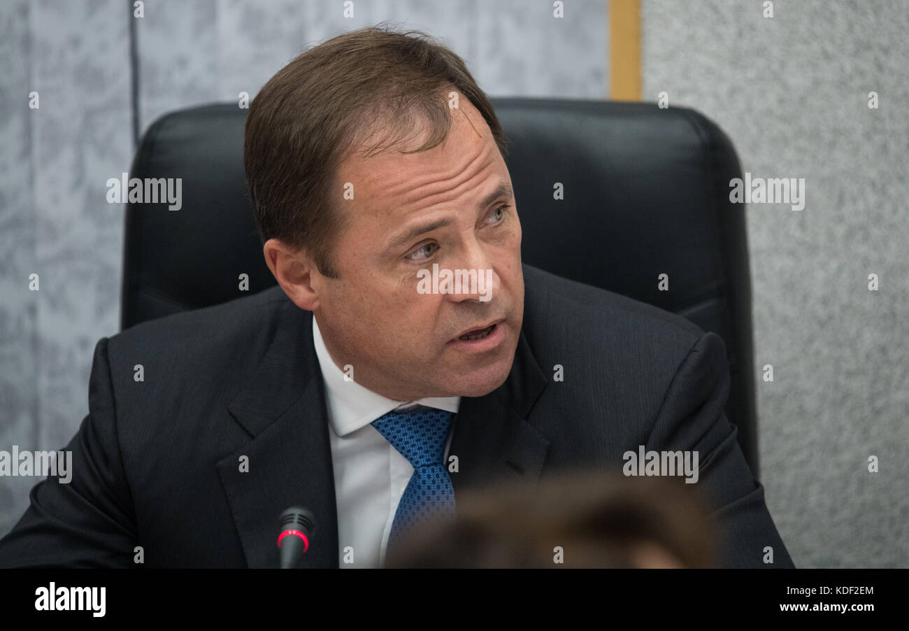 Roscosmos Director Igor Komarov speaks during the State Commission meeting to approve the Expedition 52 Soyuz MS - Stock Image
