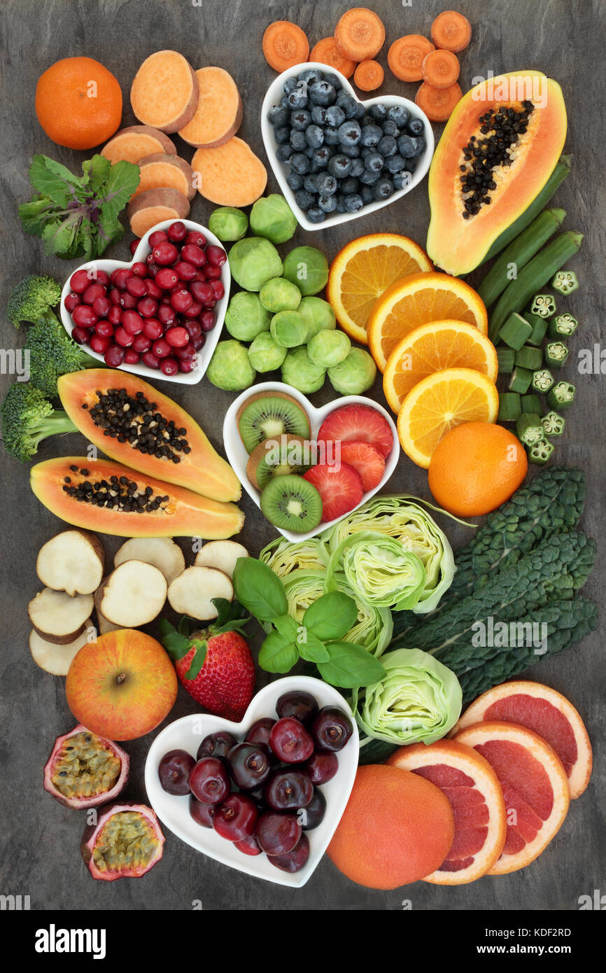 Super food for a high fiber diet with fresh fruit and vegetables, concept of foods high in smart carbohydrates, - Stock Image