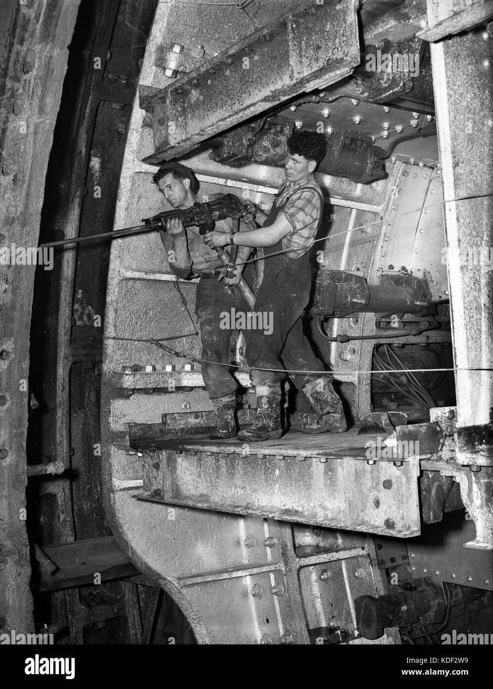 Construction workers with pneumatic drill tunnelling for London Underground 1947 - Stock Image