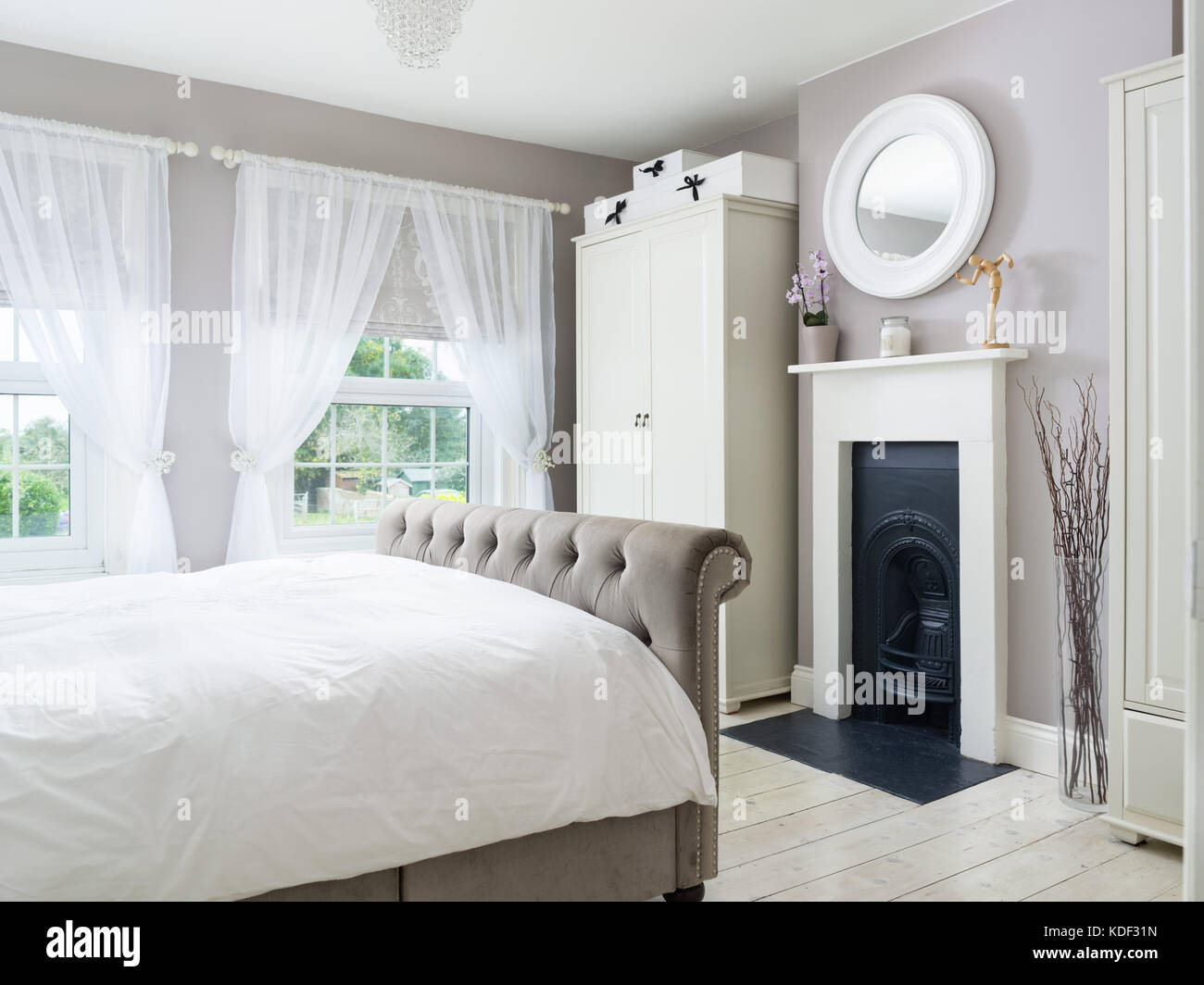 A stylishly decorated bedroom in a refurbished Victorian, UK home. - Stock Image