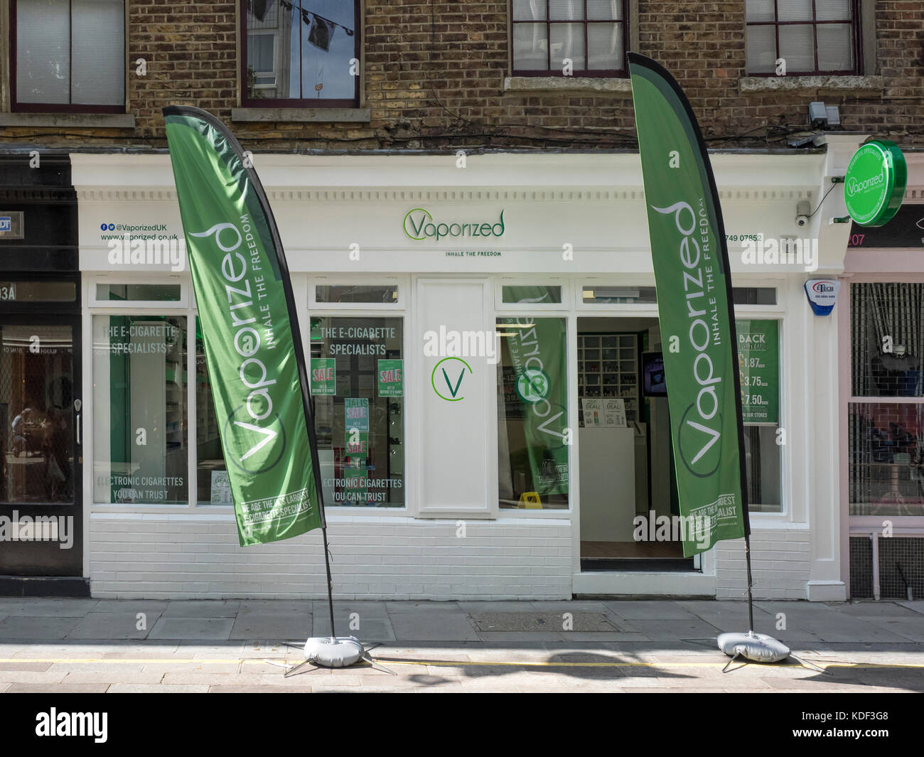 WHITECROSS STREET, LONDON:  Vaporized Store - on of a chain selling electronic cigarettes and e-liquids - Stock Image