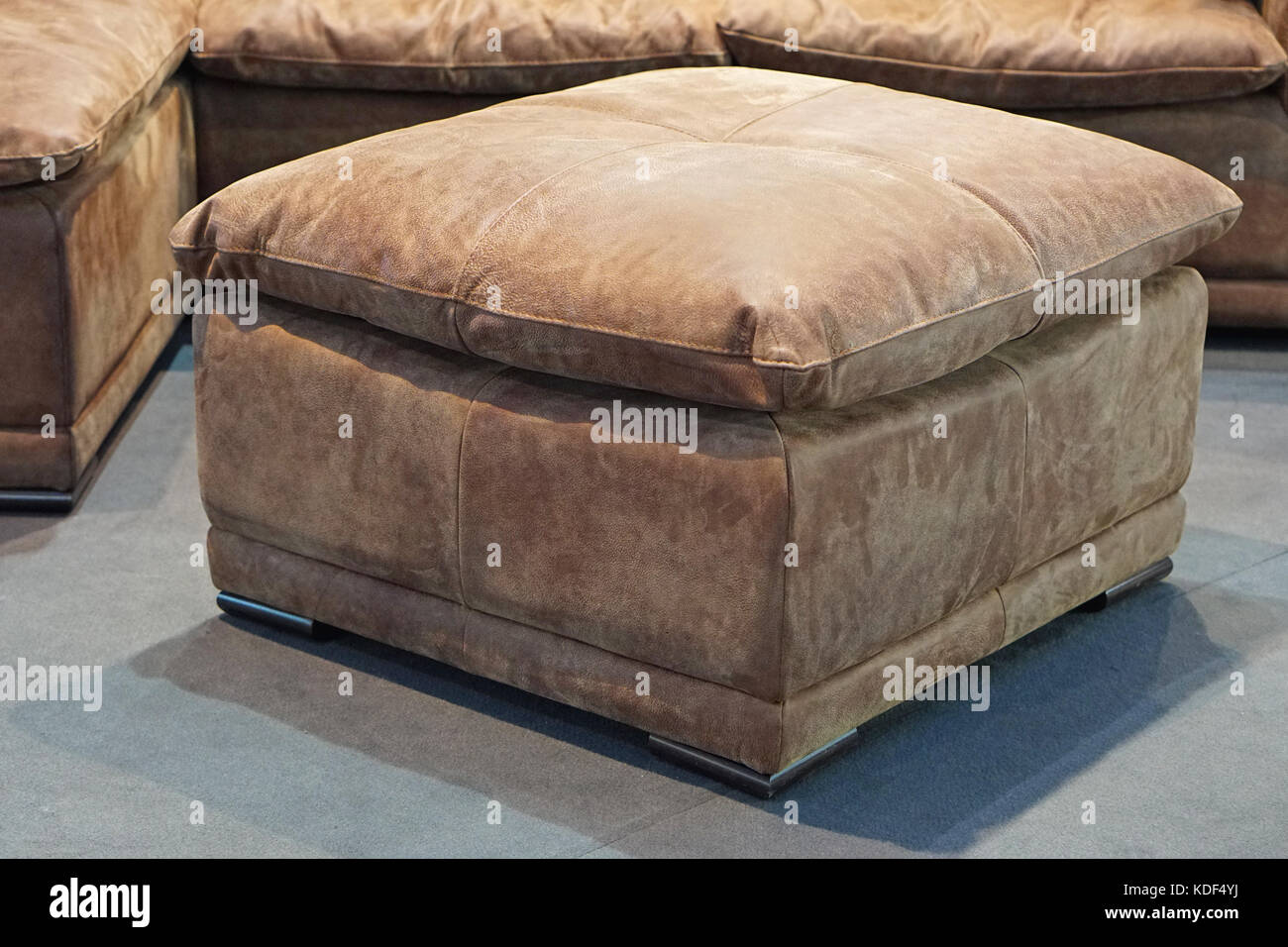 Big leather footstool in living room - Stock Image