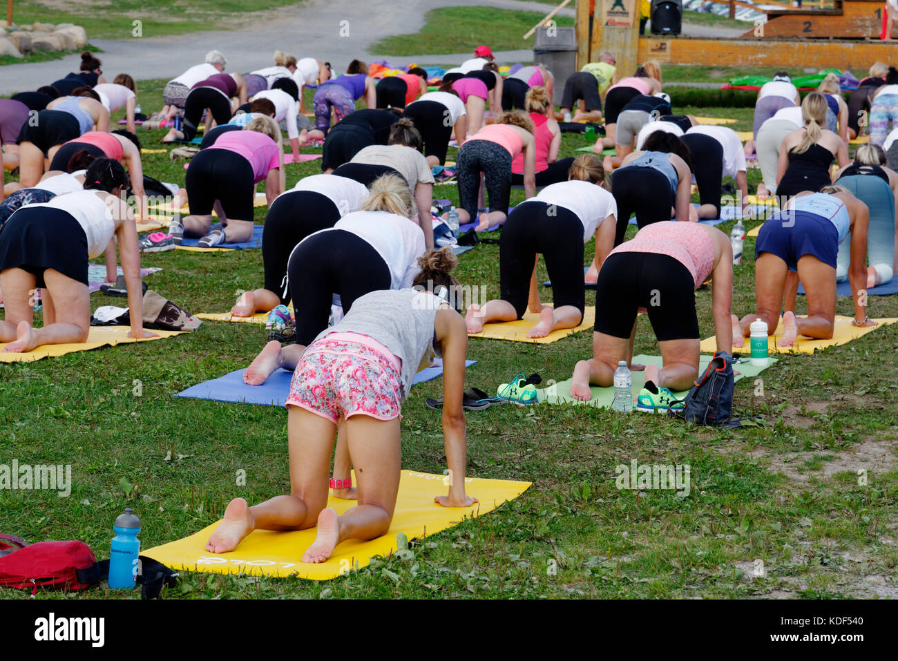 An outdoors yoga class at Mont Sainte Anne in Quebec Canada Stock Photo