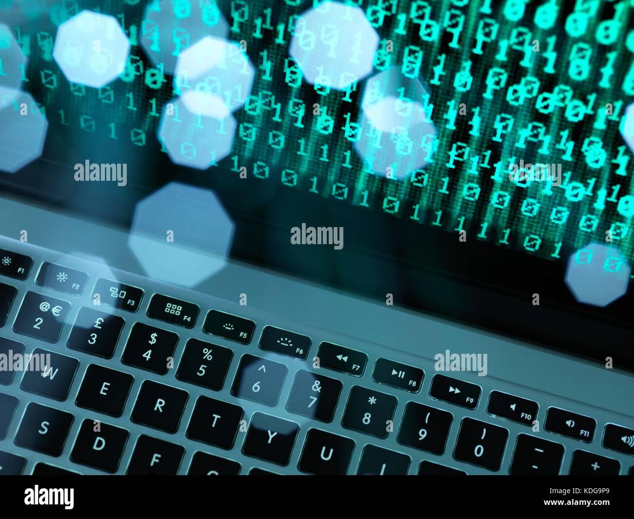 Fibre optic data containing a computer virus hitting a laptop screen. - Stock Image