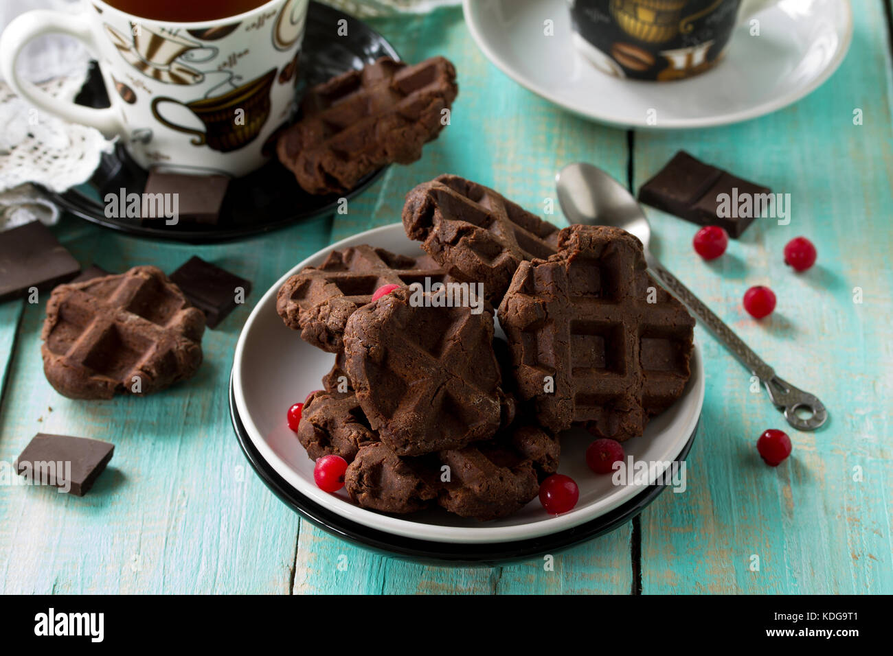 Homemade Belgian chocolate wafers with fresh berries and mint on a gray stone or slate background, Christmas background. - Stock Image