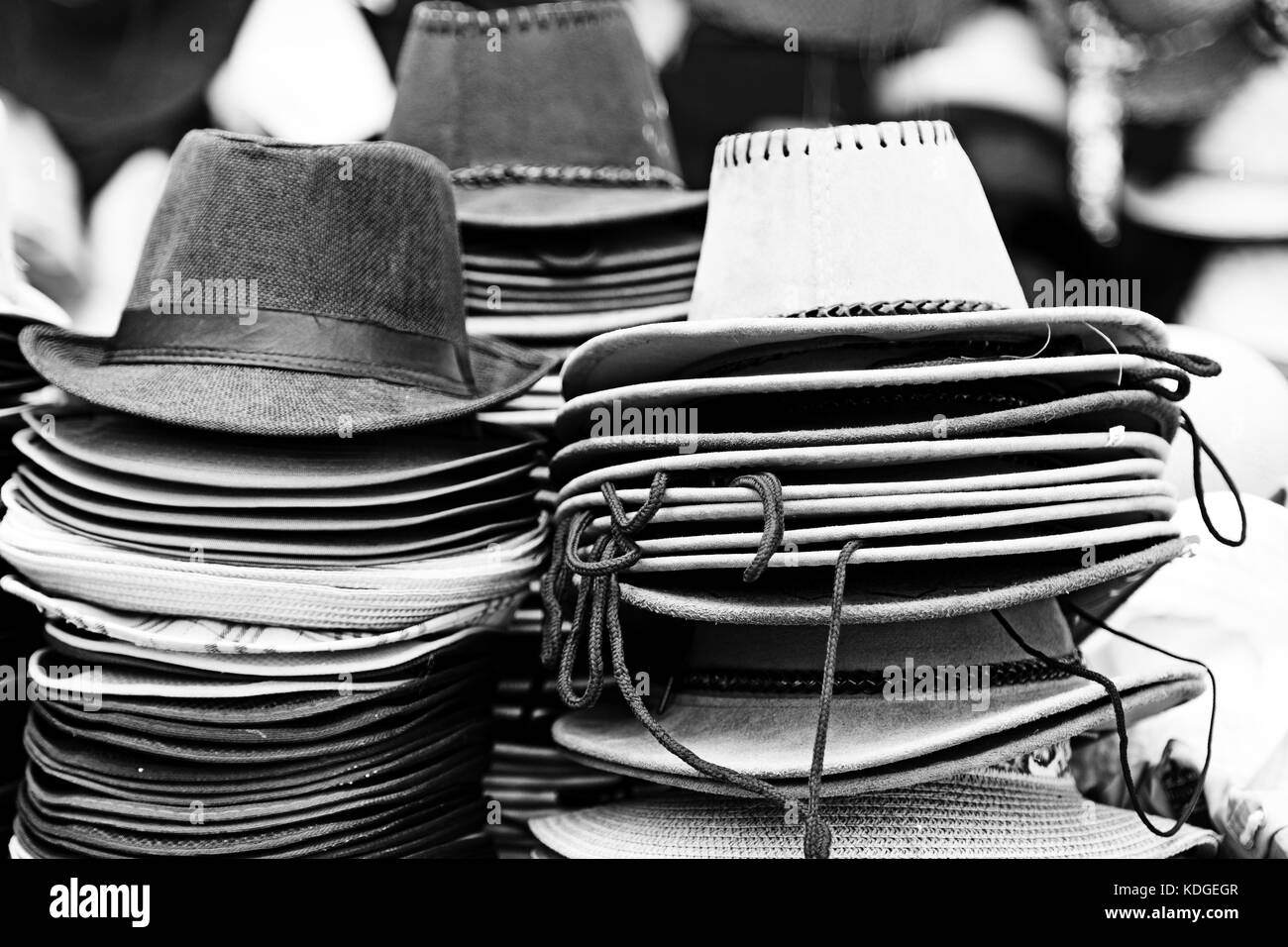 in a old market lots of colorated hats  like background clothes - Stock Image