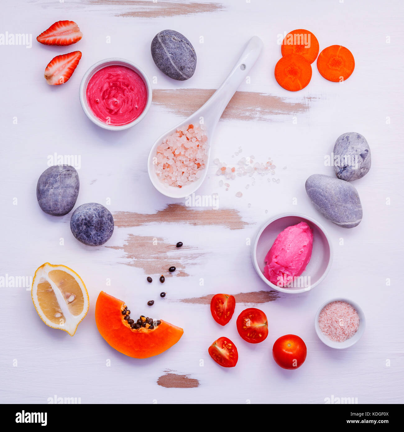 Homemade skin care and body scrubs with red natural ingredients strawberry ,tomato ,himalayan salt, papaya, carrot - Stock Image