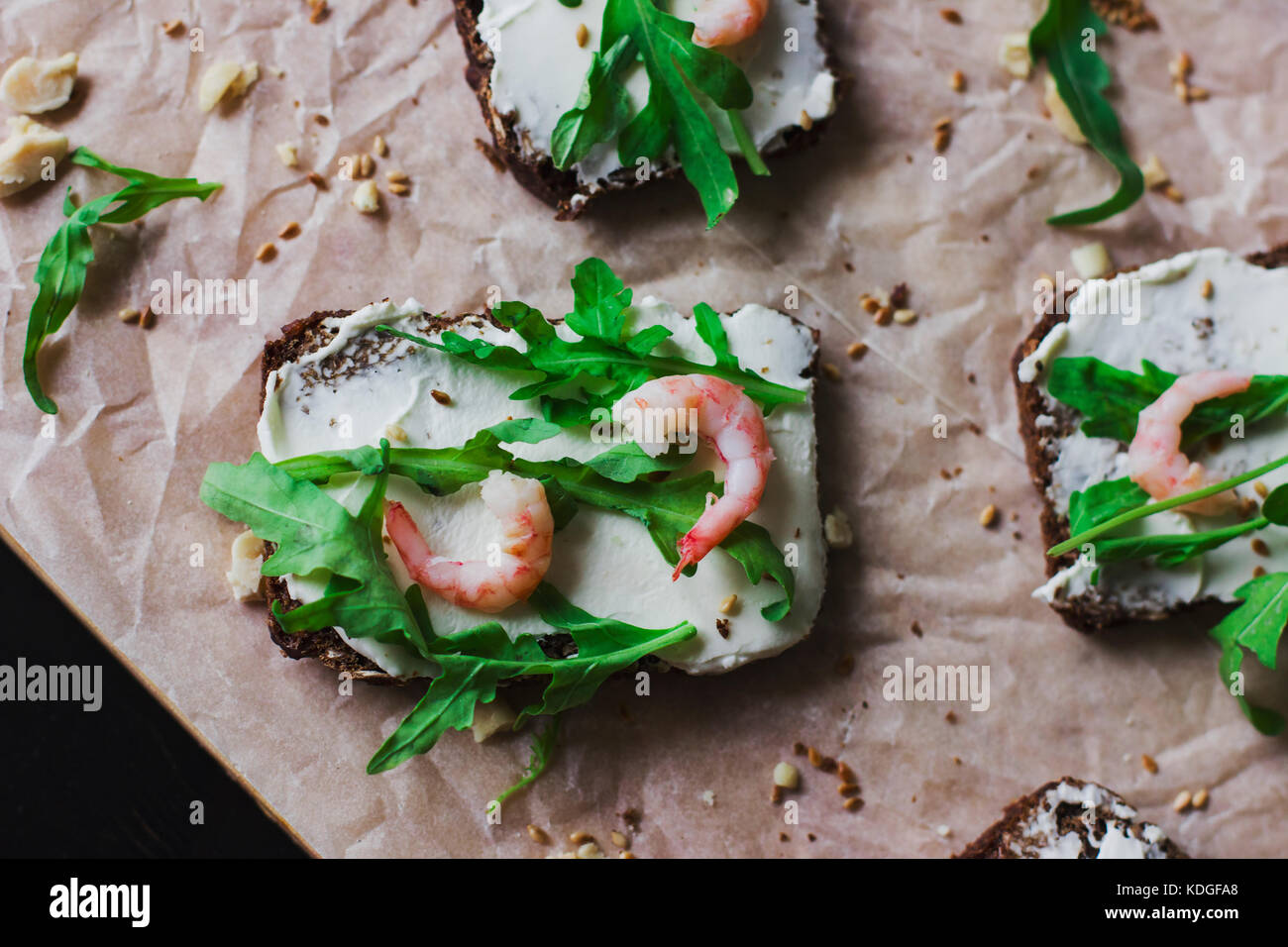 The sandwiches on grain bread with ricotta cheese and shrimp - Stock Image