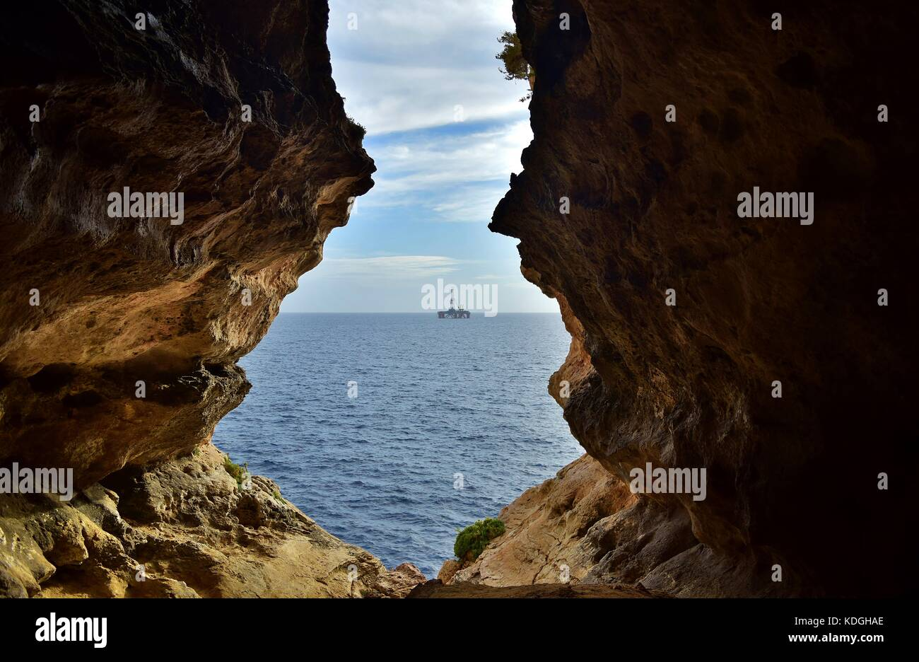 The view from sea cave, formed through weathering / erosion of Maltese limestone. The exit of the cave faces the Stock Photo