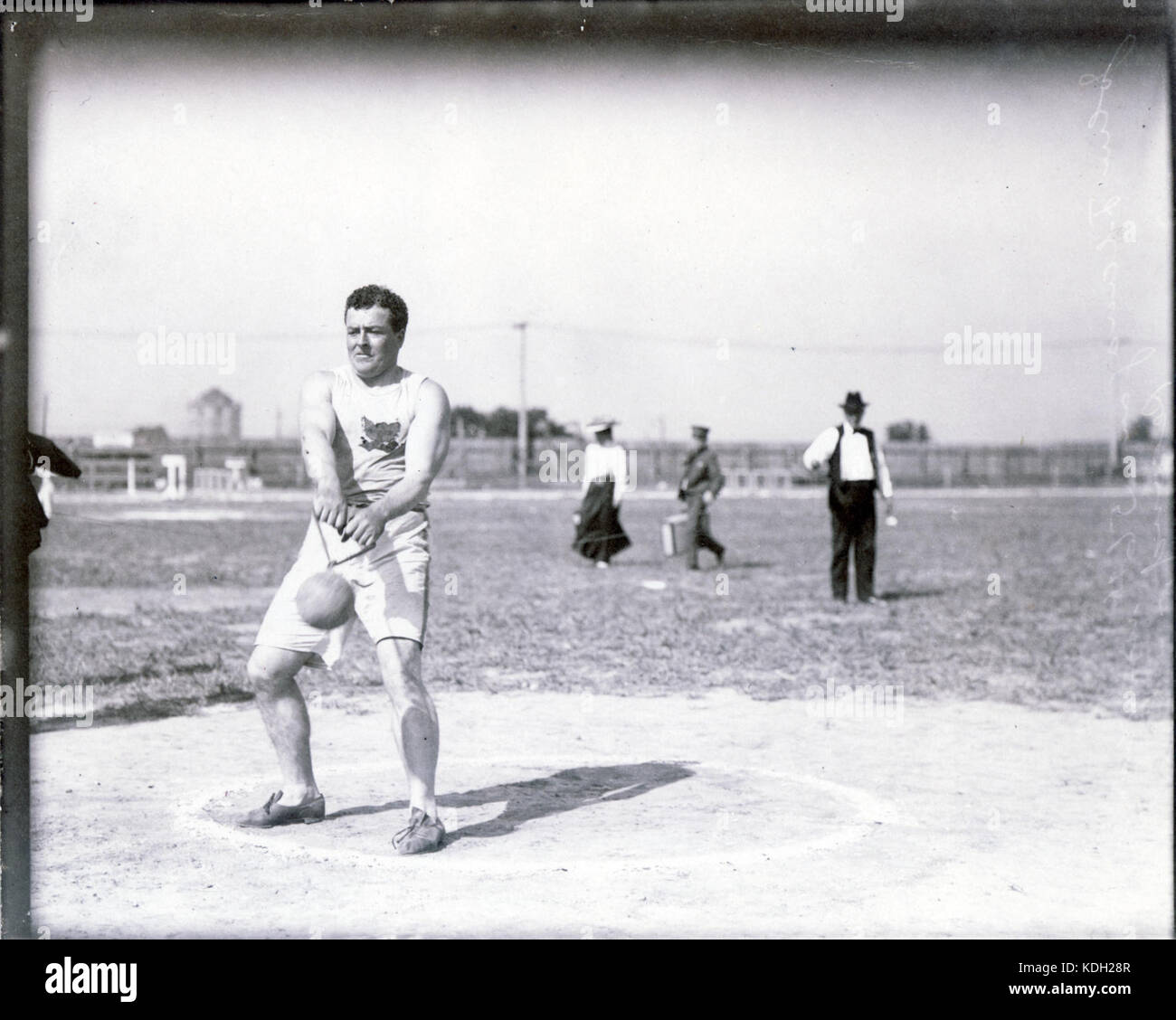 John Flannigan of the Greater New York Irish Athletic Association performing the 56 pound hammer throw at the 1904 - Stock Image