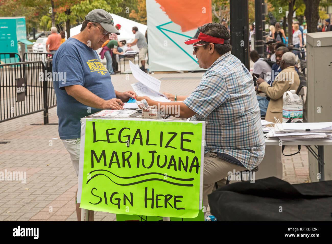 Grand Rapids, Michigan - A man circulates a ballot petition to legalize recreational marijuana in Michigan. - Stock Image