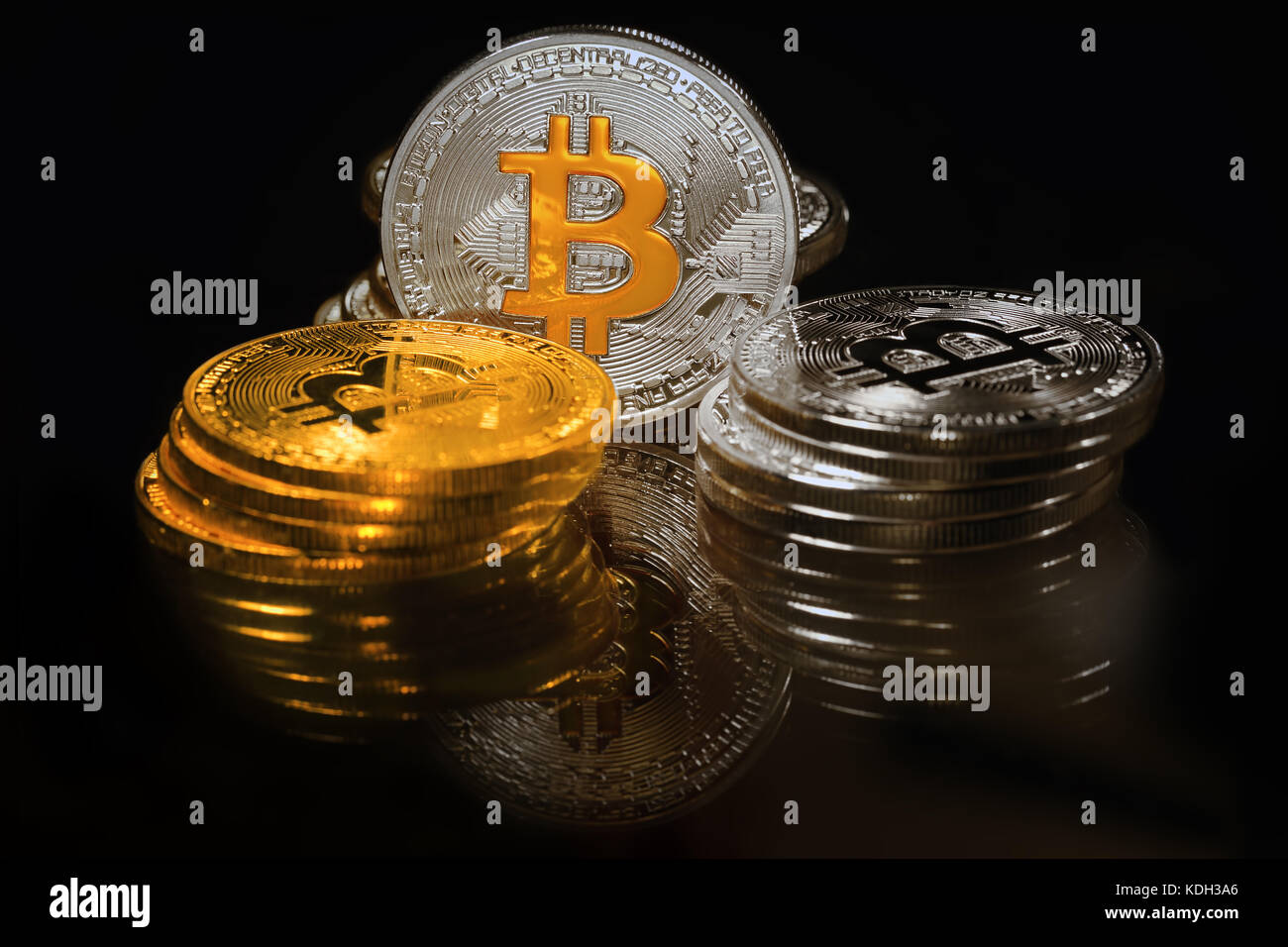 Golden and silver bitcoins on black background. Bitcoin is cryptocurrency Stock Photo