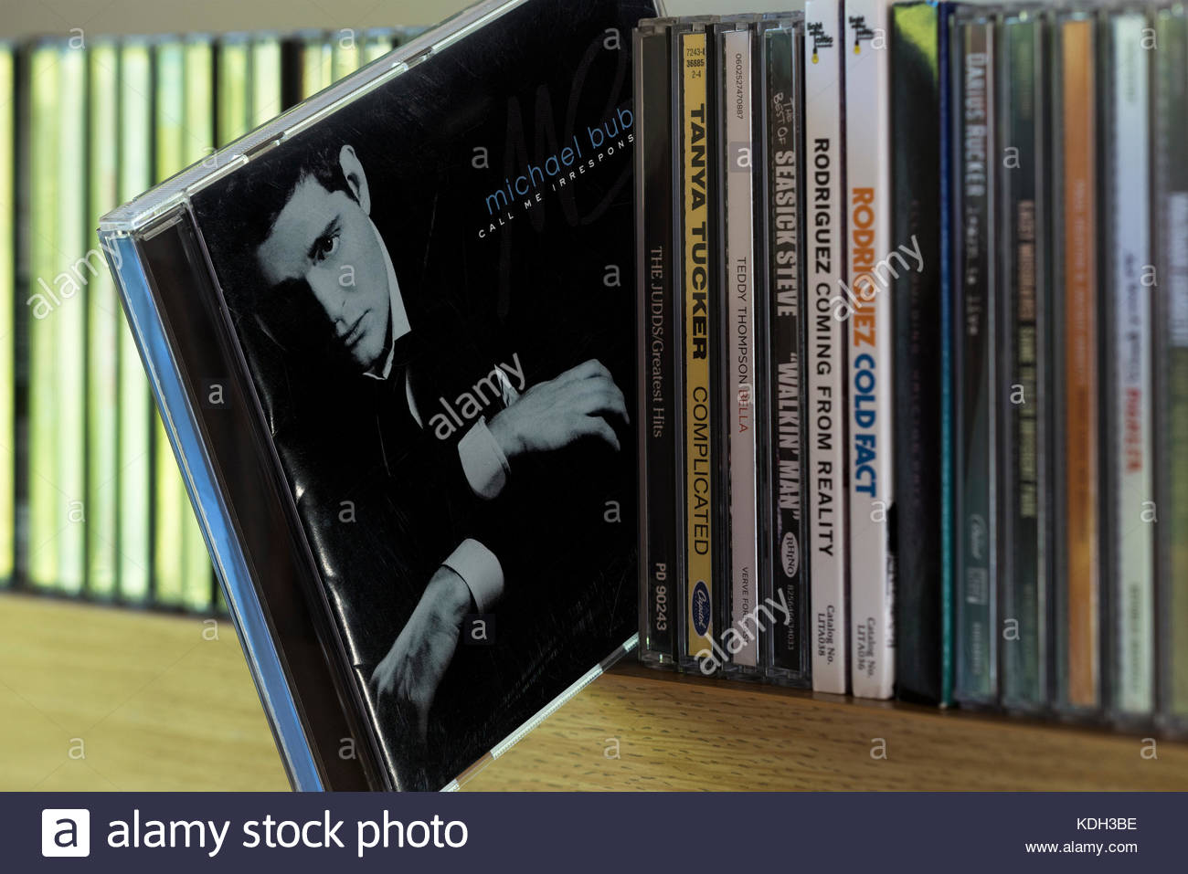 Call Me Irresponsible, Michael Bublé CD pulled out from among other CD's on a shelf, Dorset, England - Stock Image