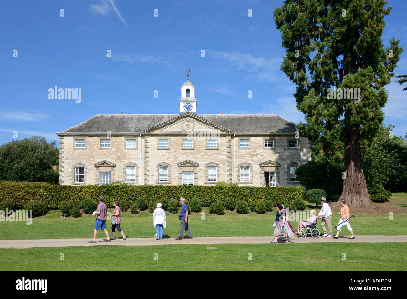 Visitors Walk Past the Stable Block (1735) at Compton Verney House, Kineton, Warwickshire, England - Stock Image