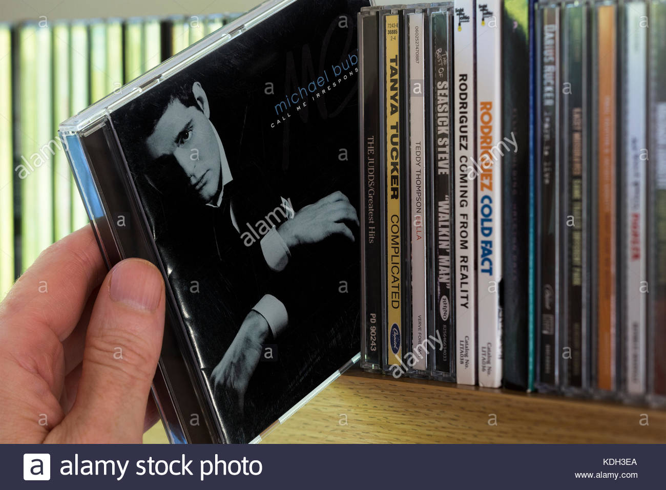 Call Me Irresponsible, Michael Bublé CD being chosen from a shelf of other CD's, Dorset, England - Stock Image