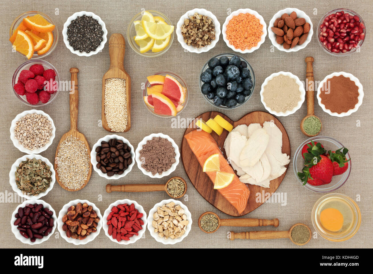 Super food for healthy dieting with high protein fish and meat, fruit, pulses, nuts, cereals and grains including - Stock Image