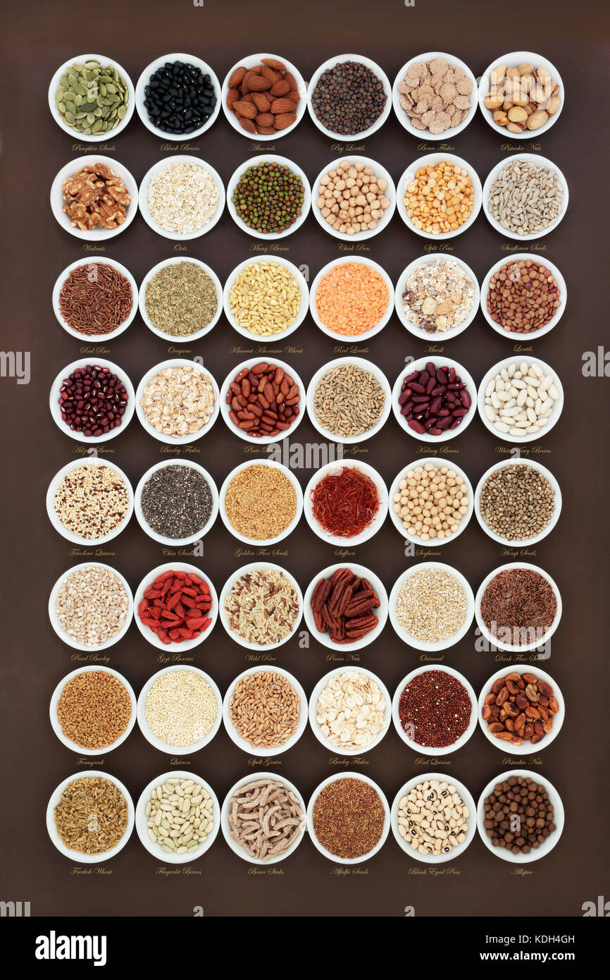 High fiber health food sampler with cereals, nuts, seeds, grain, fruit, herbs and legumes, high in omega 3 fatty - Stock Image