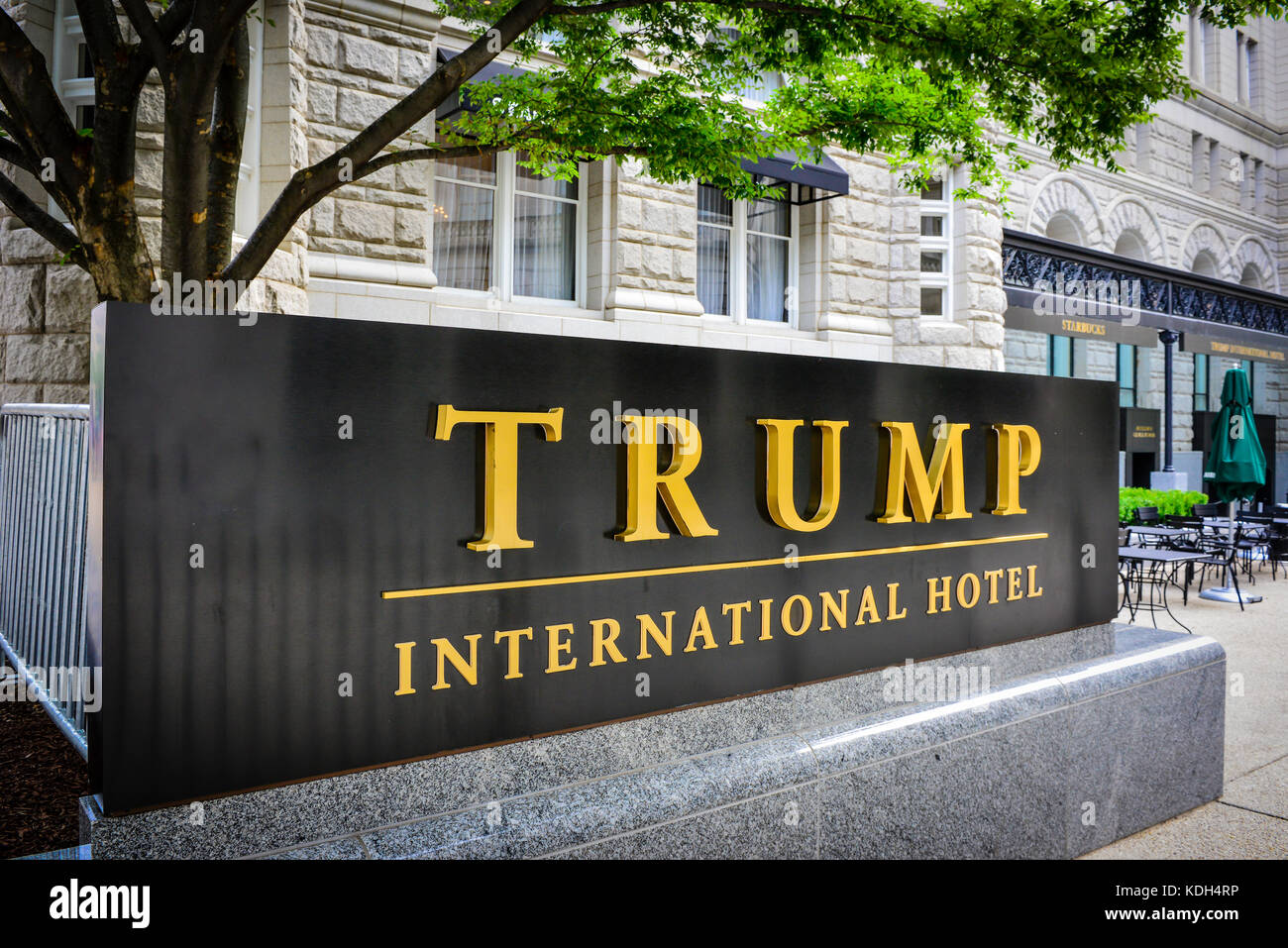 The big golden TRUMP International Hotel sign in front of the renovated Old Post Office Building on Pennsylvania - Stock Image
