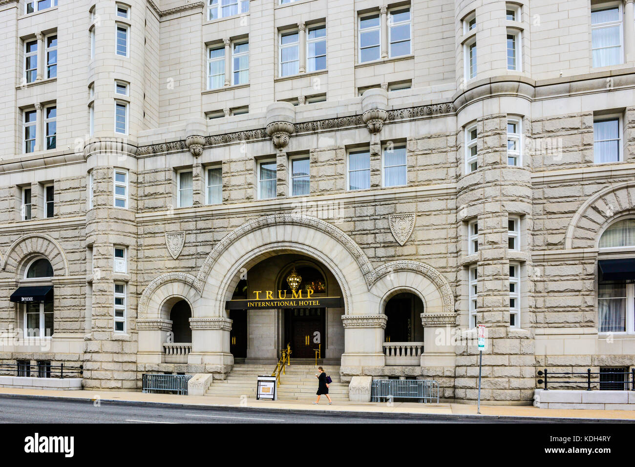 The golden TRUMP International Hotel sign in front of the renovated Old Post Office Building on Pennsylvania Avenue - Stock Image