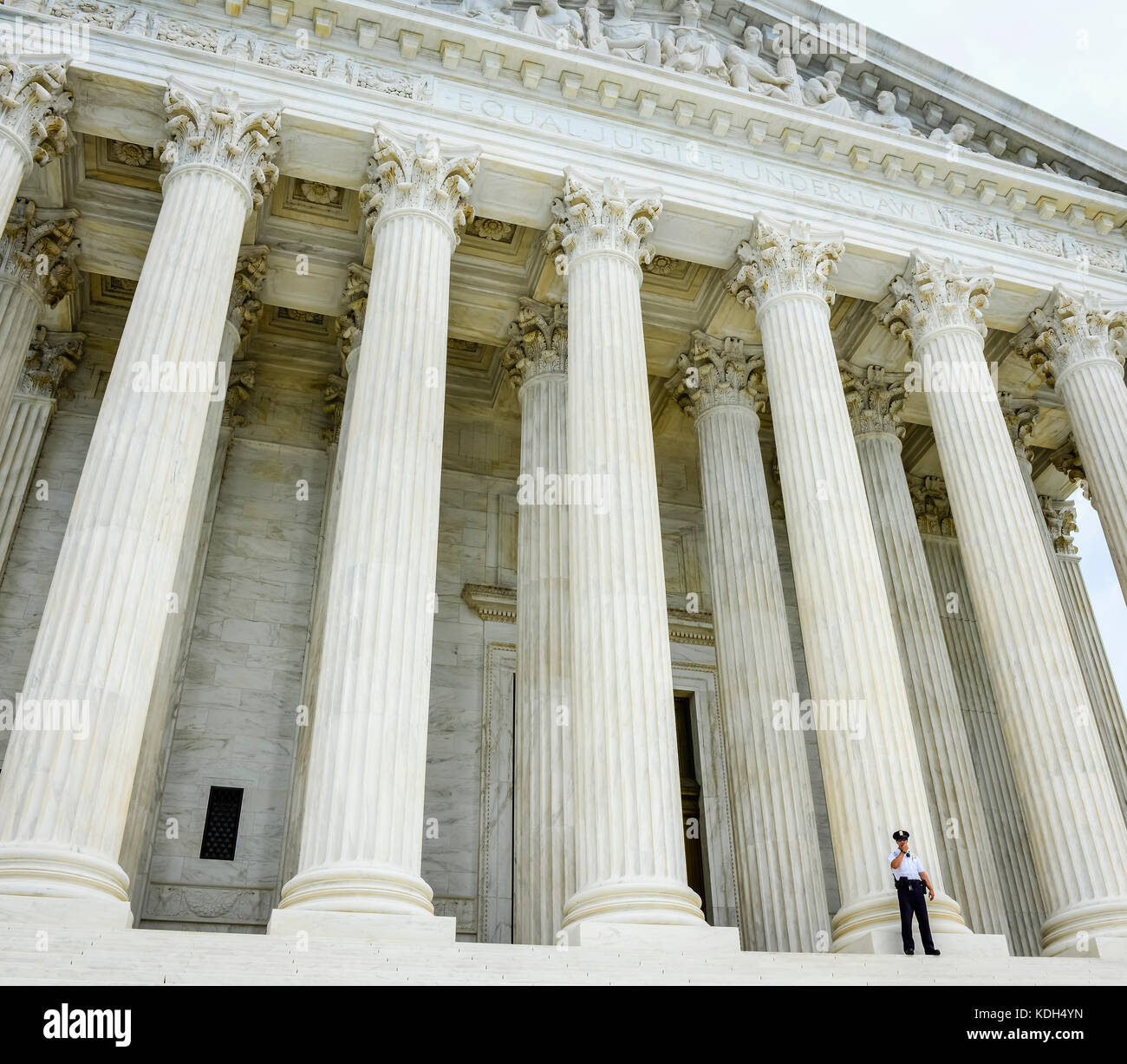 A lone security guard in front of the entrace to the majestic US Supreme Court in Washington, DC, USA - Stock Image