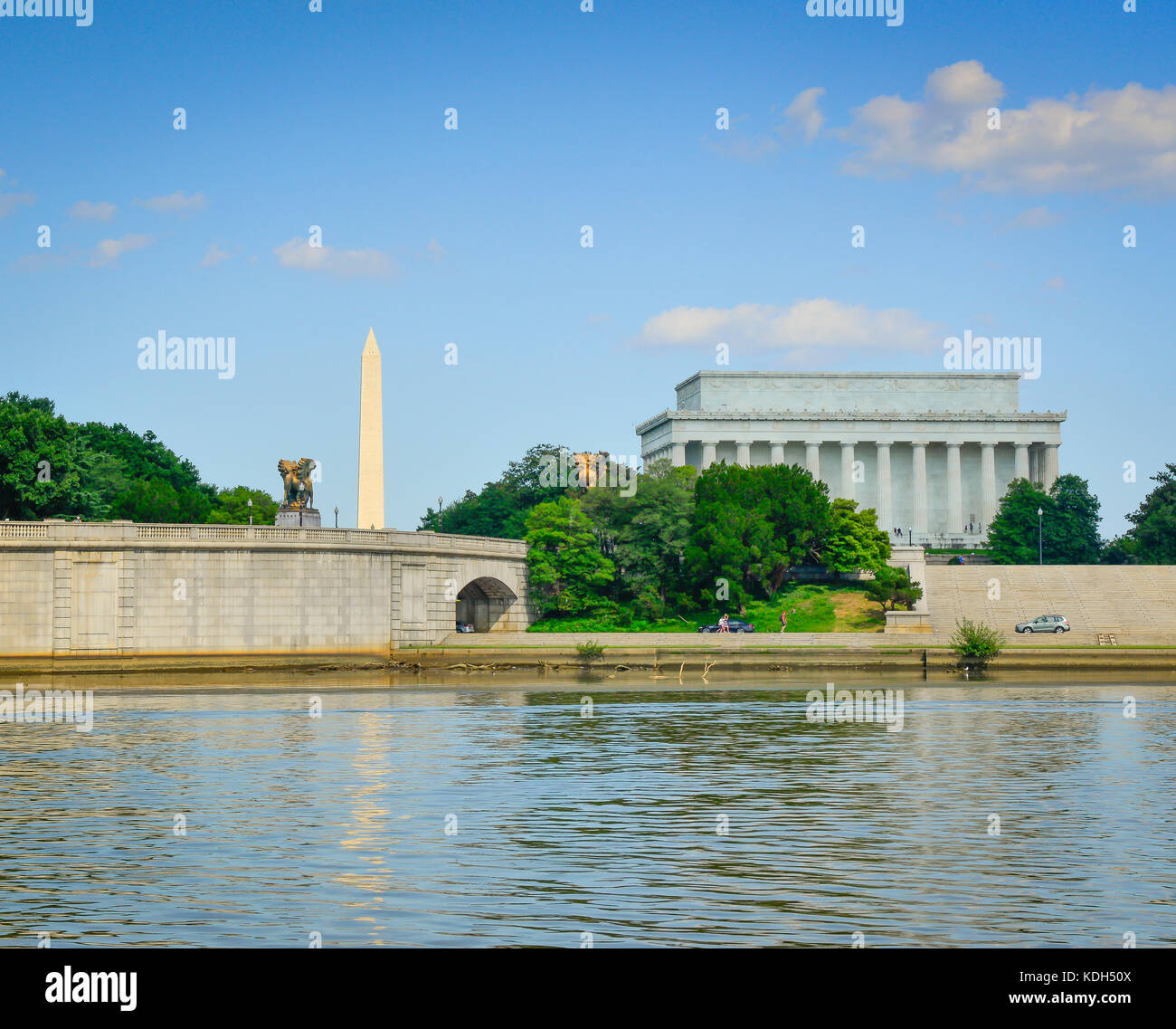 The Arts of Peace bronze statues seen from the Potomac river with the Washington monument and Lincoln Memorial in - Stock Image