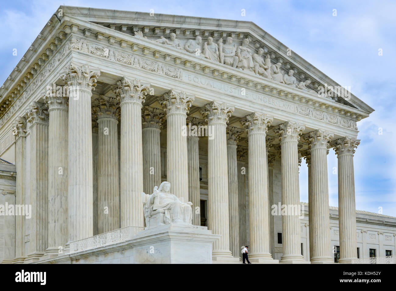 Security guard walks in front of entrance to the US Supreme Court Building in Washington, DC, USA - Stock Image