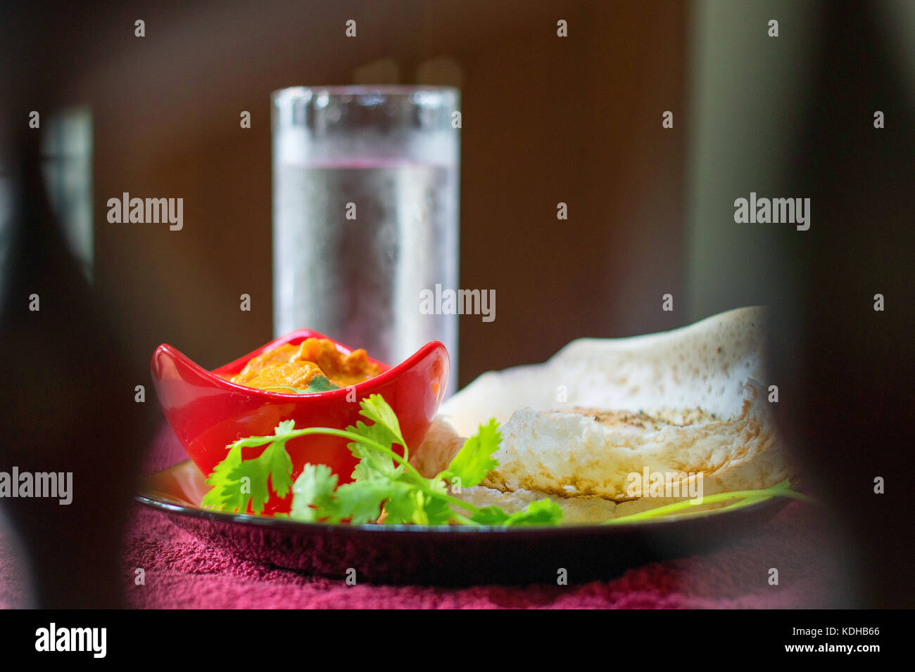 Indian Gee rice with complete curry meal served on a tray in a restaurant - Stock Image