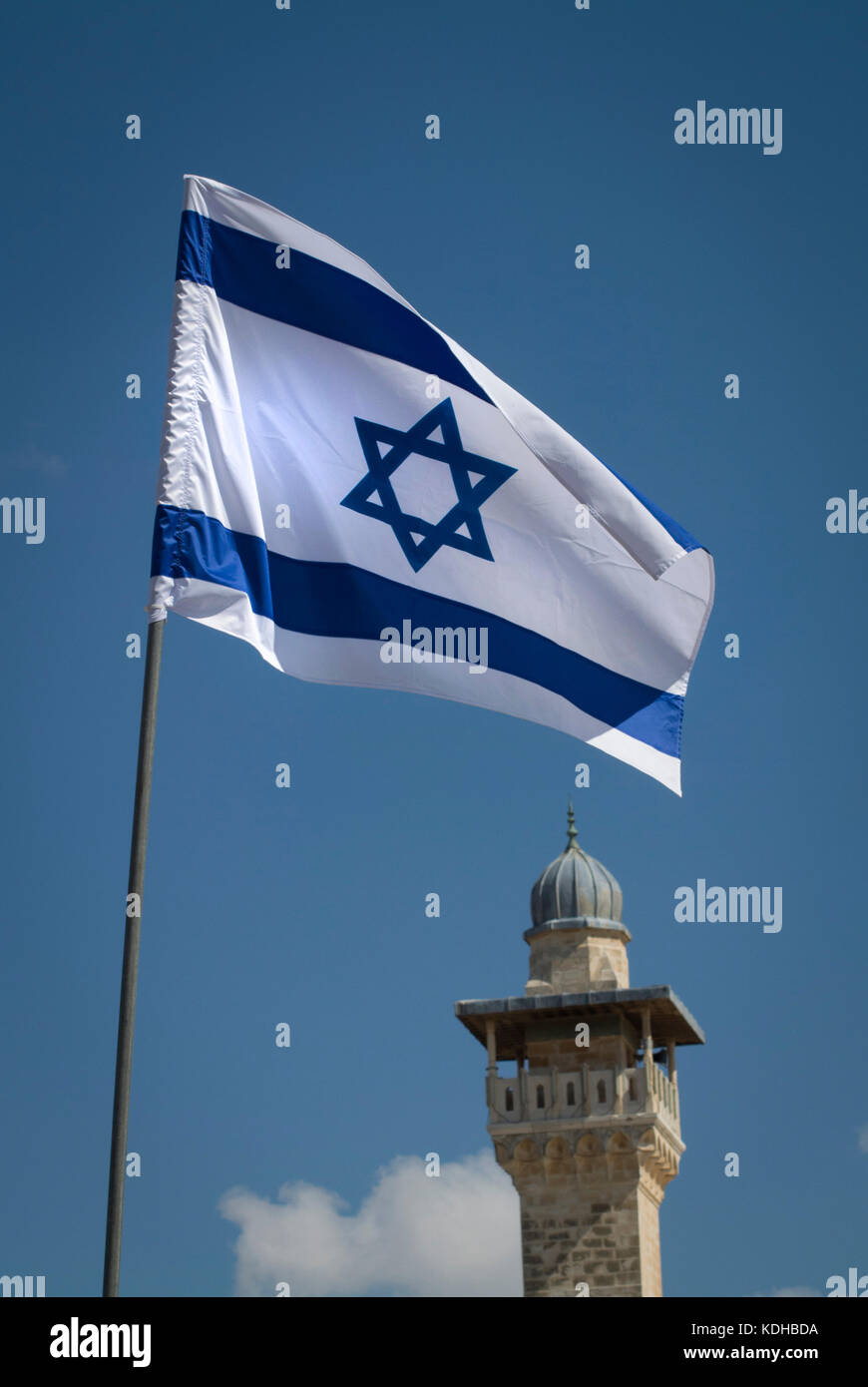 The flag of Israel with a minaret behind at the Western Wall in Jerusalem, Israel Stock Photo