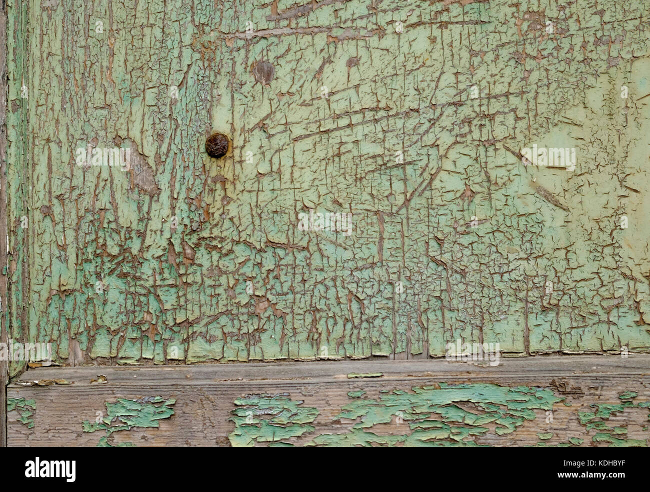 Patina of faded and cracked green paint - Stock Image