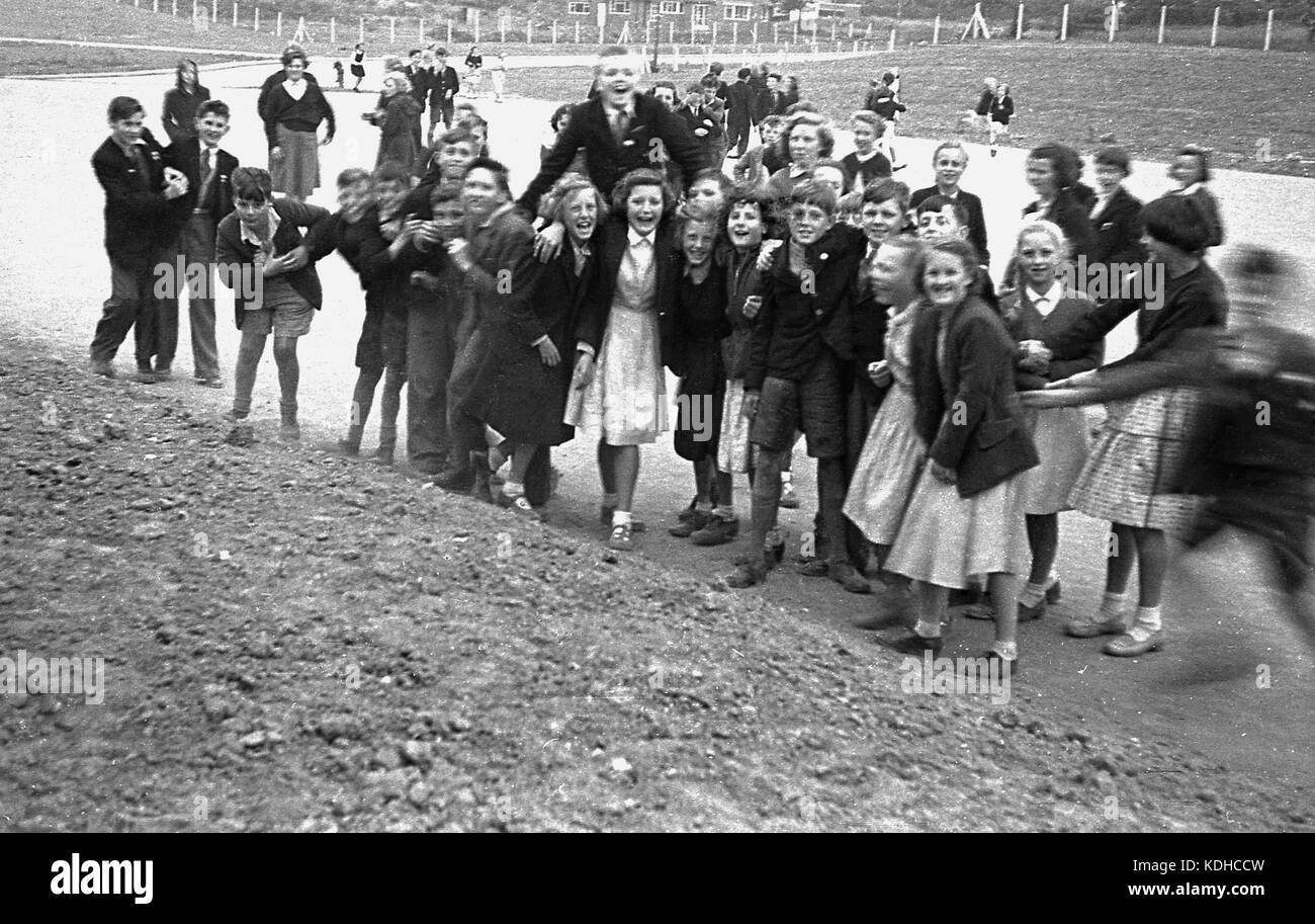 1960s, historical, in this picture we see a group of English secondary school children, boys - some wearing shorts - Stock Image