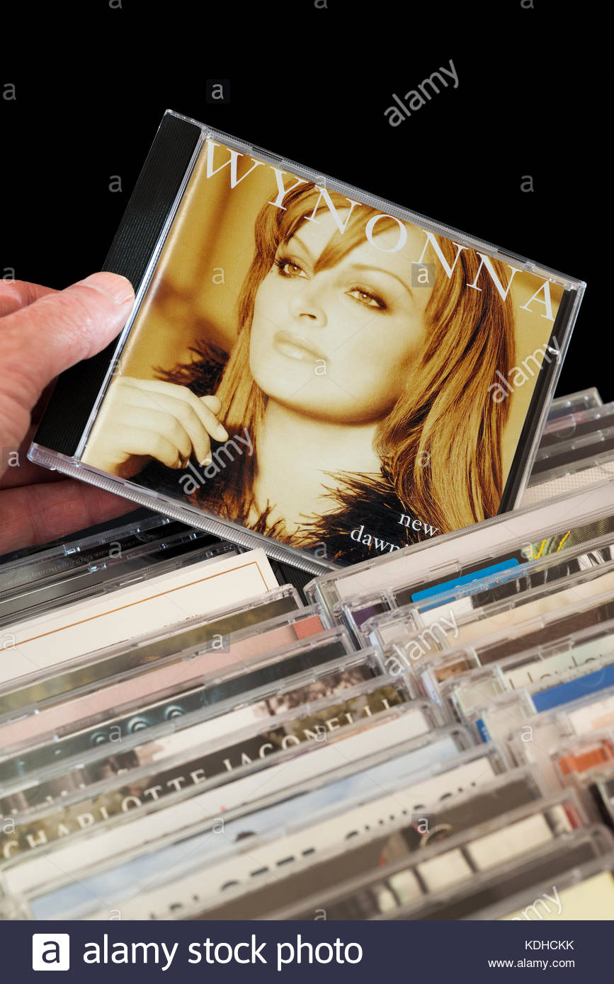 New Day Dawning, Wynonna Judd CD being chosen from among rows of other CD's Dorset, England - Stock Image