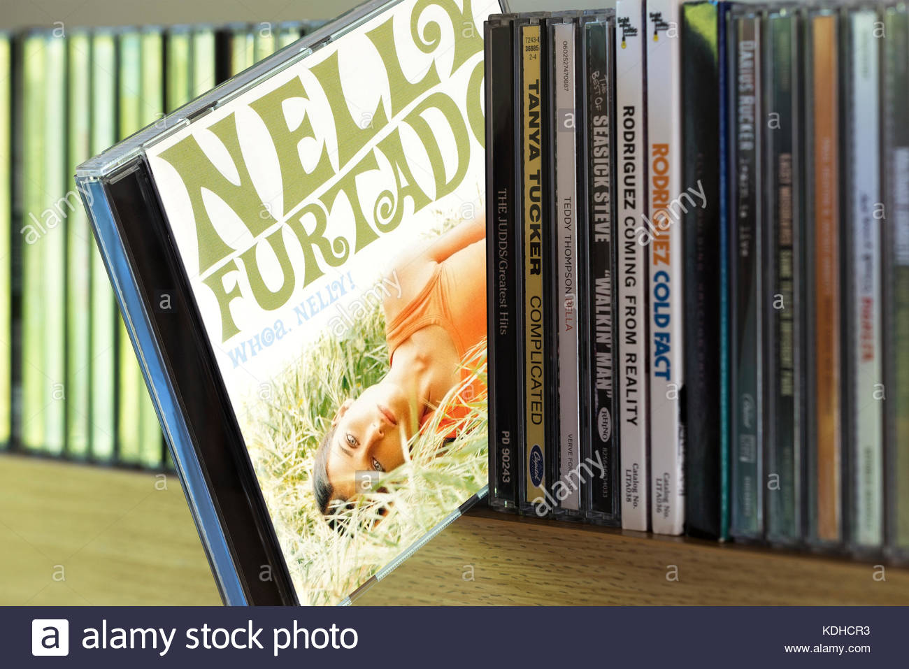 Whoa Nelly , Nelly Furtado CD pulled out from among other CD's on a shelf, Dorset, England Stock Photo
